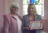 Pat Golding was presented with a certificate and clock to commemorate 50 years service to the Pymoor Methodist Chapel as organist, 2014.