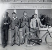 Stan Butcher, Dick Bailey, Eric Butcher and Kenneth 'Tripper' Bailey outside Saberton Stores, Main Street, Pymoor, circa 1950