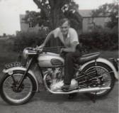 Derrick Godbold on his motorbike on Pymoor Hill, circa 1950