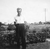 Derrick Godbold in the front garden of his house at No 4, Council Houses, Main Street, Pymoor, circa 1950