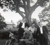 Dennis Hall, Hubert Stevens, Bill Cornwall and Derrick Godbold by the conker tree on Pymoor Hill, circa 1950