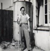 Derrick Godbold in his back garden at No 4, Council Houses, Main Street, Pymoor, circa 1950.