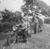 Bill Cornwall and Hubert Stevens on a motorcycle in Pymoor, circa 1950