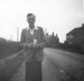 Derrick Godbold in Main Street, Pymoor, circa 1950.