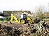 A JCB was used to clear some land off Pymoor Lane of trees, Nov 2014