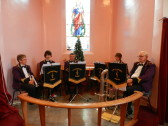 Littleport Brass Band getting ready for Pymoor and Coveney Methodist Chapels' Carol Service, 2014