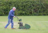 Michael Saberton preparing the wicket at the Pymoor Cricket Club, 2015