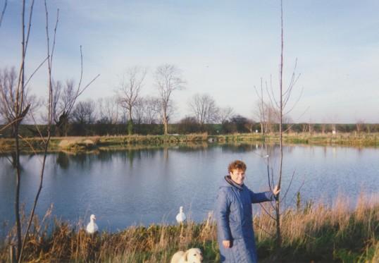 Cynthia Parson, pretending to plant a tree at Oxlode Fishing Lakes, Oxlode, 1994