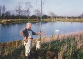 Les Barker planting trees at the Oxlode Fishing Lakes, 1994