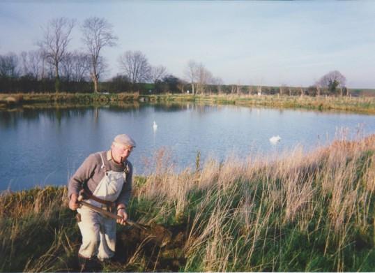 Les Barker, planting a tree at the Oxlode Fishing Lakes, Oxlode, 1994