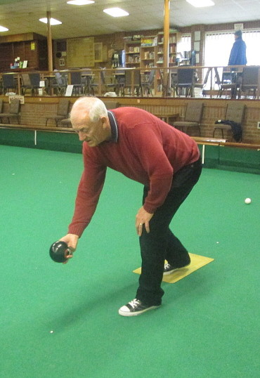 Roger Davis of Pymoor, playing bowls at the City of Ely Bowls Club, 2015