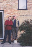 Thomas and Les Barker outside Pymoor Lane Farm, 2005