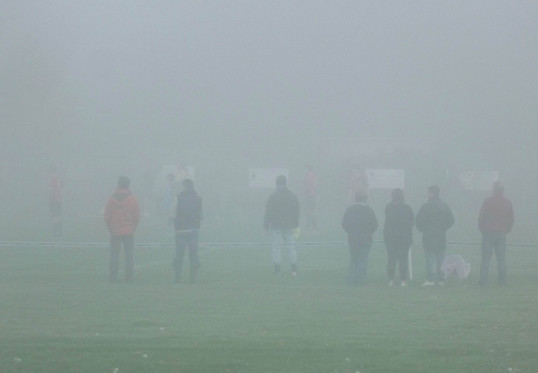 Spectators had difficulty seeing the match as Ely Crusaders played in the fog at the Pymoor Cricket Club Ground, 2015