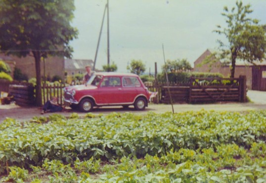 Sid Dewsbury outside his home on the corner of Pymoor Lane and Main Street, Pymoor, circa 1968