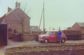 Nelly Dewsbury outside her home on the corner of Pymoor Lane and Main Street, Pymoor, circa 1968