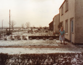 Alice Baker standing outside her House in Main Street Pymoor 1985