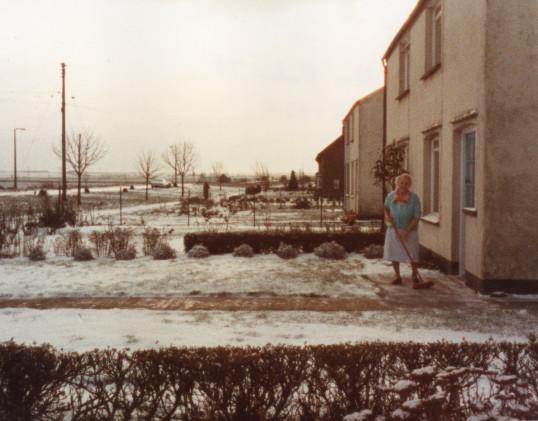 Alice Baker standing outside her House in Main Street Pymoor 1985