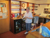 Rosemary Davis cleaning one of the bars in the Pymoor Cricket Club, 2016