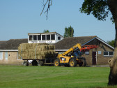 Richard Golding driving a Caterpillar TH 407 Telescopic Handler past the Pymoor Cricket Club, Pymoor, 2016
