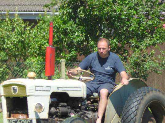 Tony Ure preparing the field at the Pymoor Club for the start of the new football season, 2016