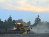 Combine Harvester working at Oxlode Farm, Pymoor, 2015
