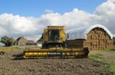 A New Holland CSX 7080 Combine Harvester at Oxlode Farm, Pymoor, 2015.
