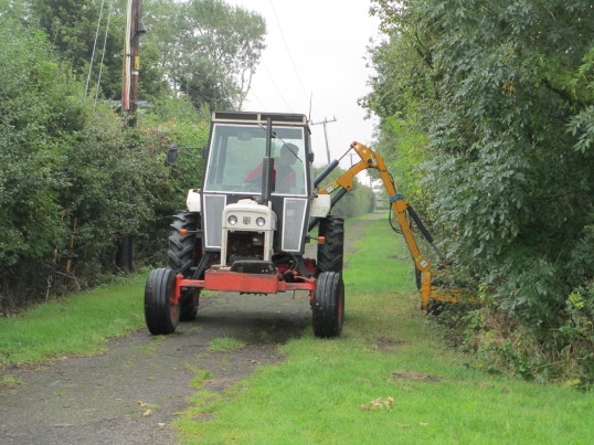 Matthew Golding trimming hedges along School Path, Pymoor, 2015