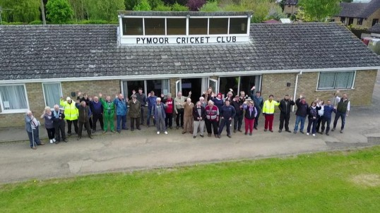 Participants in the Vintage Tractor Rally gather for a photograph outside the Pymoor Cricket Club, 2017