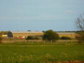 Willow Farm and the Corkers Crisp Factory, seen from Pymoor Lane, Pymoor, 2017