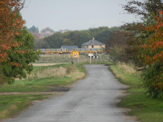 Train passing Laurel Farm viewed from Pymoor Lane, 2016