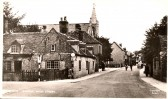 High Street, Ramsey. At the corner with School Lane.  Building on left now site of Temperence Court.
