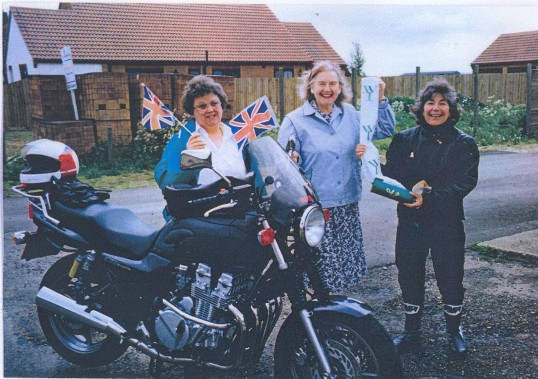 Mrs Cumbridge and Mrs Lines of Ramsey Mereside WI hand scroll to Jenny Waters of Ramsey St Mary's WI. It was then taken to Huntingdon by Dorothy.