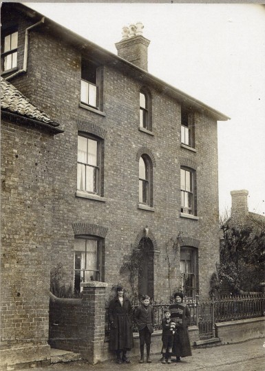 Olive, Raymond, Burt & Mrs Mary Hales, outside their house in Mill Lane, Wistow