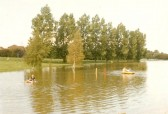Children enjoying the boating lake, normally the Ramsey Golf course at Bury.
