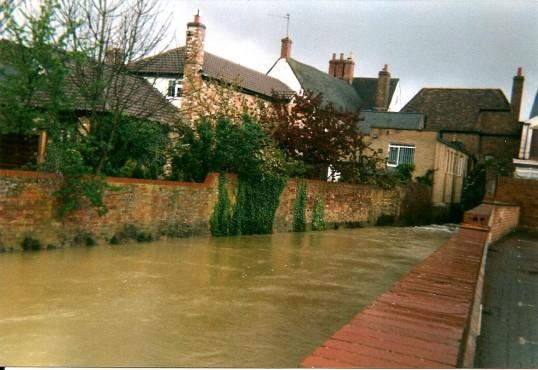 Bury Brook in flood at rear of High Sreet, Ramsey