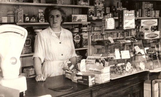 Mrs Doris Wade in her grocers shop at 80 Great Whyte, Ramsey