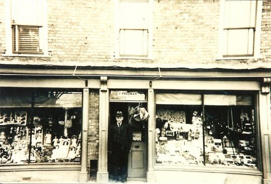 Mr John Freeman at his original shop at 54 High Street, Ramsey