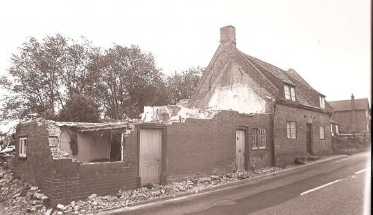Nearly down! Houses next to Babinda House, High Street, Bury.
