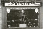 H.R Wade's Shop in Great Whyte,Ramsey. Showing the window dressed for the celebration of the Silver Jubilee of King George V.