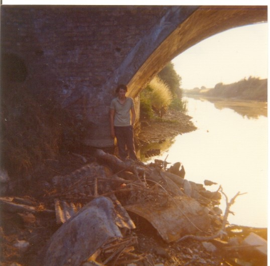 Neil Fountain aged 12 standing under Ramsey Forty Foot Bridge to show the water level during the drought of 1976.