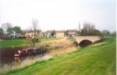 View of  Ramsey Forty Foot Bridge and Drain, showing The George Public House and two barges.
