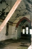 Inetior of the derelict St Benet's Church at Ramsey Hollow.
