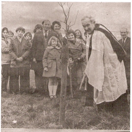 Rev George Gerrard plants 1 of 2 replacement Memorial trees at Ramsey Forty Foot.