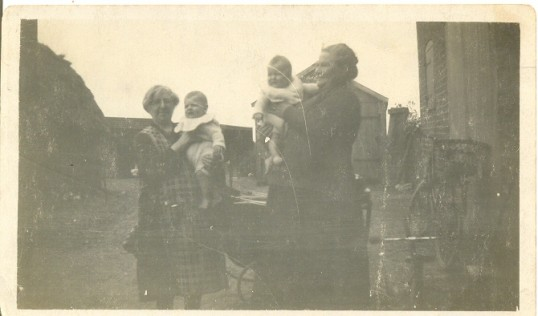Peter and Roy Chamberlain being held by Granny Crouch (maternal grandmother) and Granny Chamberlain (paternal grandmother), Oak Farm, Ramsey Hollow