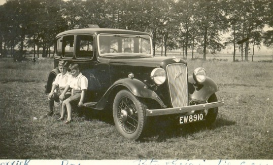 Derreck, Roy and Peter (in the driving seat) Chamberlain with a new Austin Twelve.