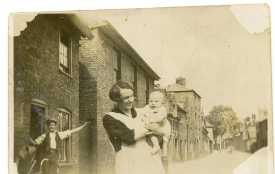 Clarence Edwards age one year being held by his mum, Alice Edwards in Little Whyte Ramsey