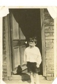Clarence Edwards age 5 years out side his House in Little Whyte Ramsey