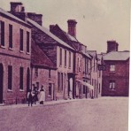 Great Whyte, looking towards Little Whyte, Ramsey. Showing White Swan public house and Parish rooms. The White Swan in now Breams shoe shop and the Parish Rooms are now the Lloyds TSB Bank.