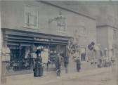 Shop front G.Hyde (later to be G.B.Hyde & Son)44 High St Ramsey. George Hyde with his daughter-in-law Alexandra