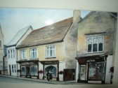 Painting showing the front view of 44 & 46 High St. Ramsey. Shop of G.B.Hyde & Son